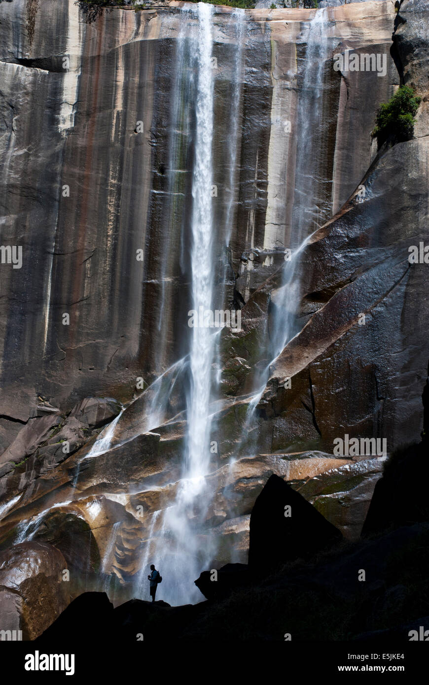 Silhouette of a person in front of Vernal Fall, Yosemite National Park, California USA Stock Photo