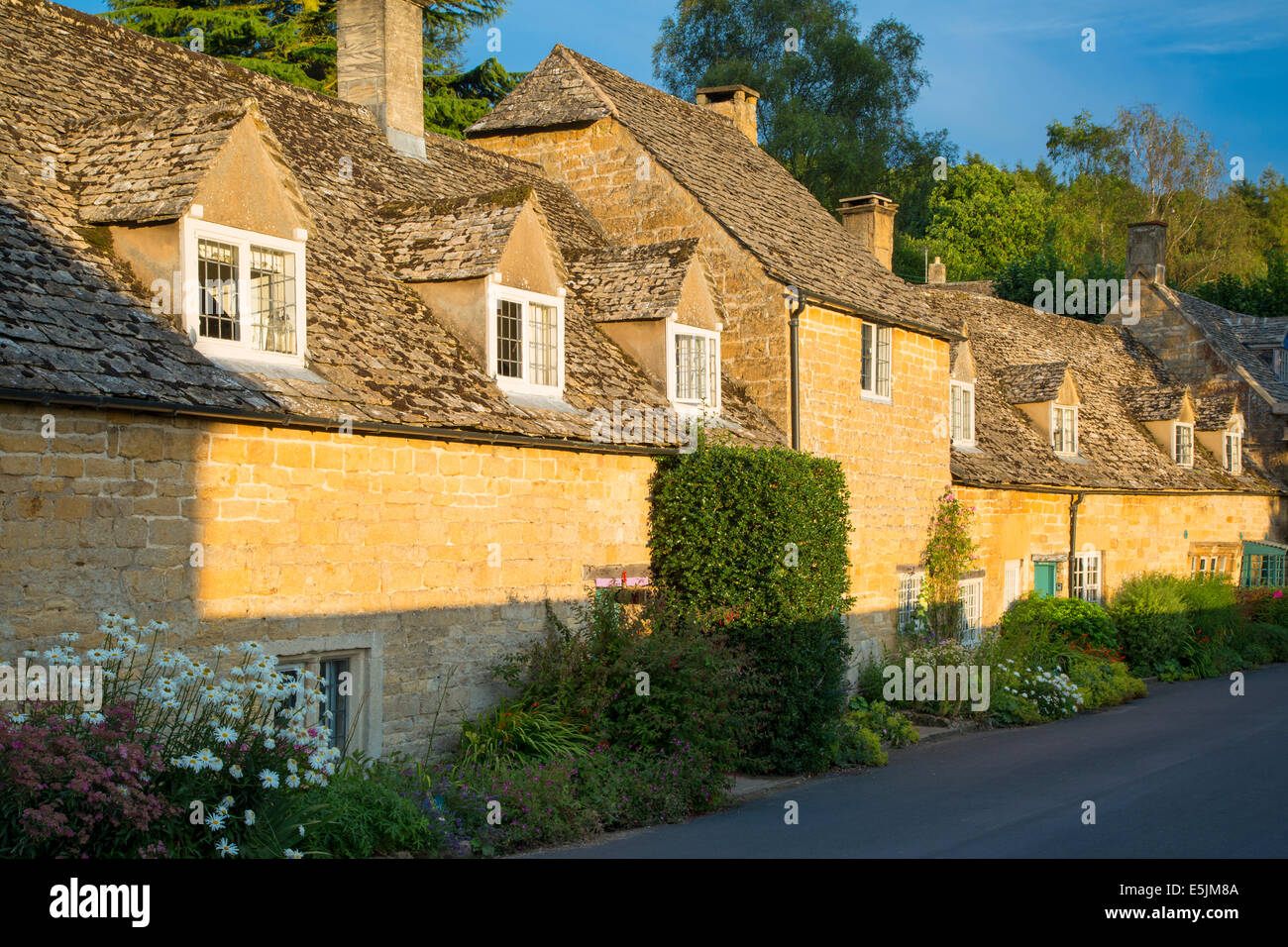 Row of attached cottages in Snowshill, the Cotswolds, Gloucestershire, England - Stock Image