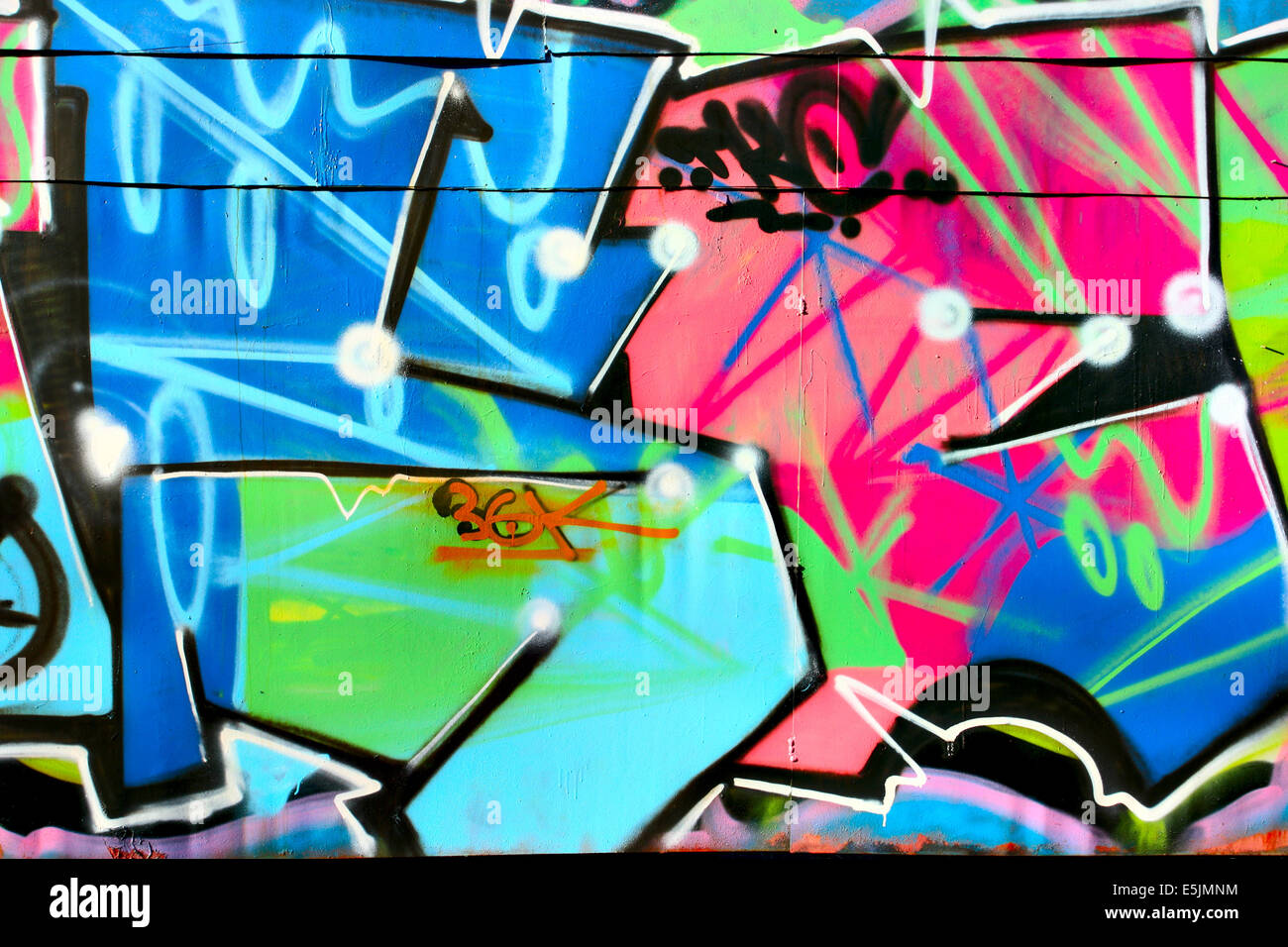 Urban graffiti close-up, may be used as background - Stock Image