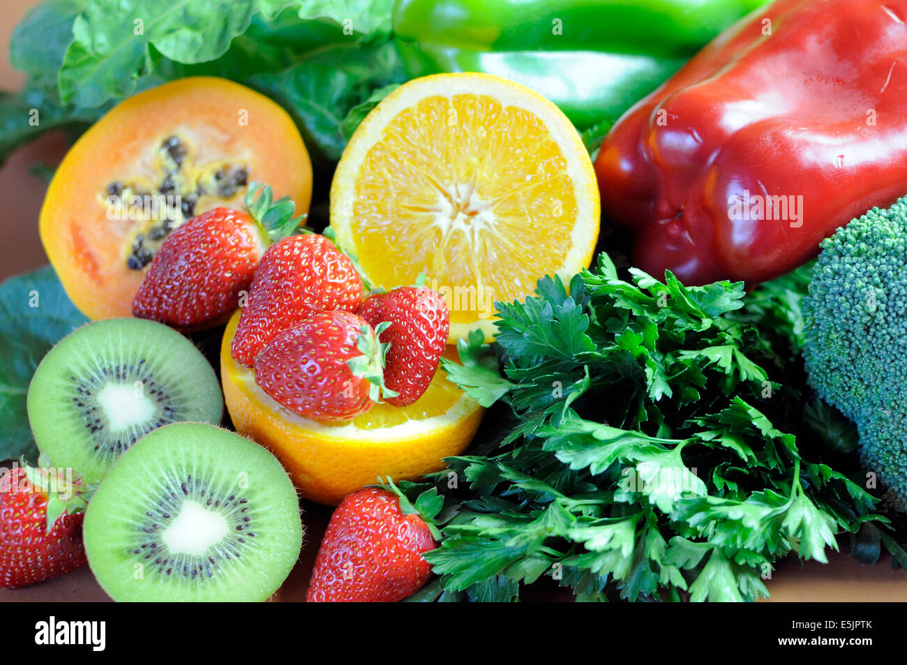 Sources of Vitamin C - oranges, strawberries, red and green capsicum peppers, dark leafy green, parsley, broccoli, - Stock Image