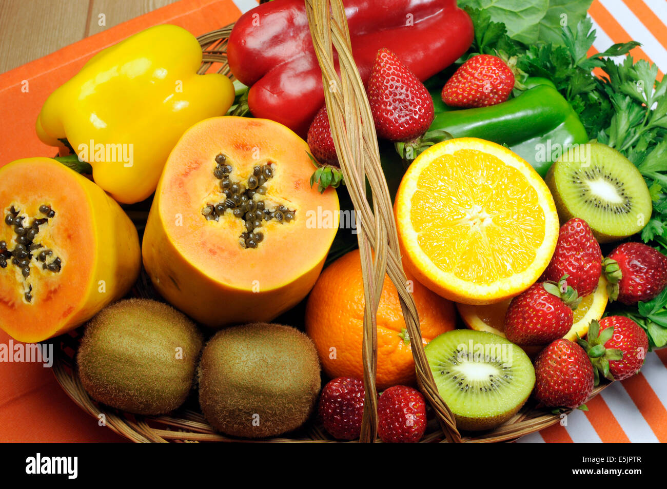 Healthy diet - sources of Vitamin C - oranges, strawberry, bell pepper capsicum, kiwi fruit, paw paw, spinach dark - Stock Image
