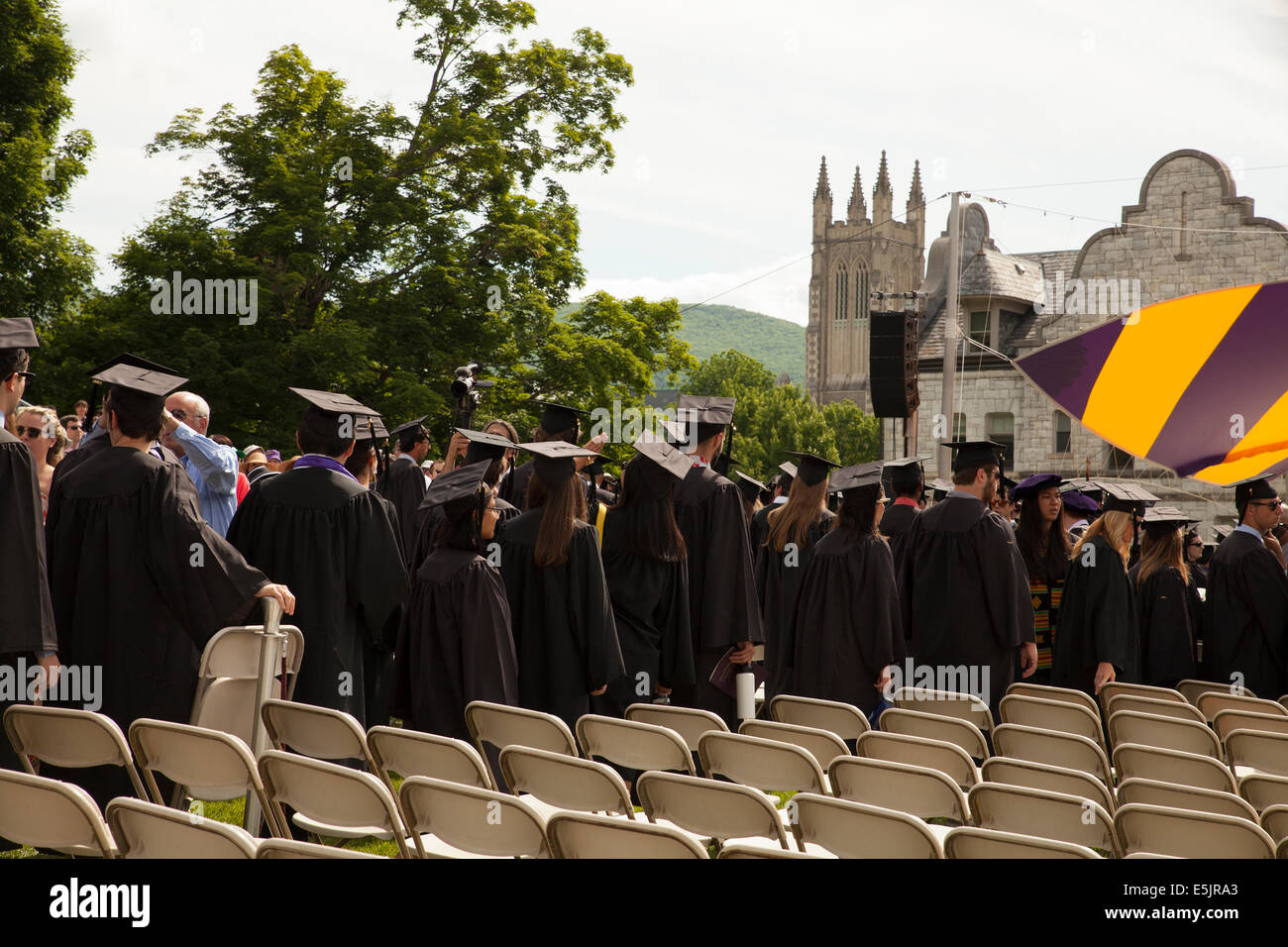 Graduating students parade into the seating area before their graduation ceremony  at Williams College  in Williamstown, - Stock Image