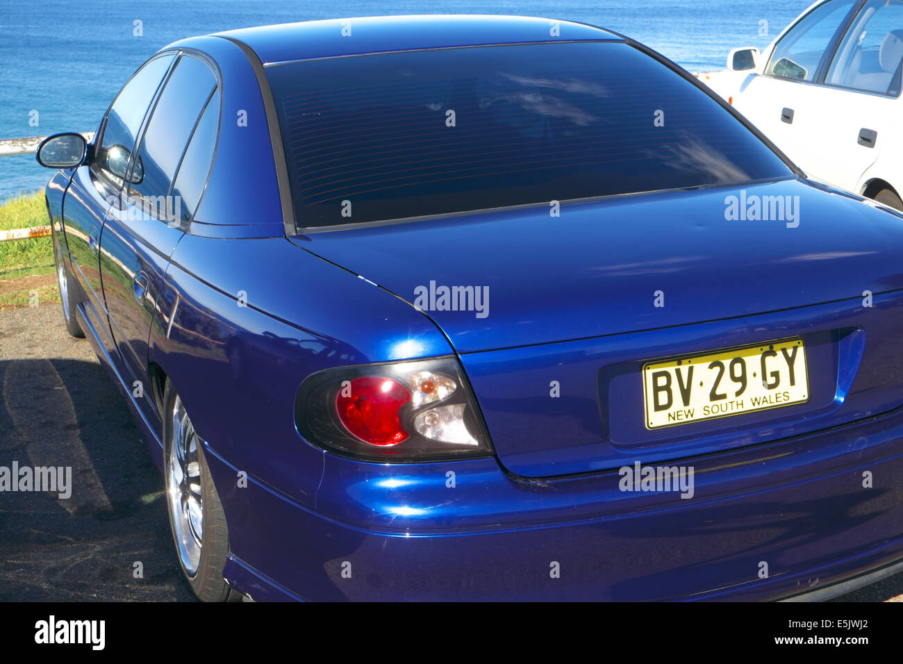Holden commodore motor car parked by a sydney beach,new south wales,australia - Stock Image