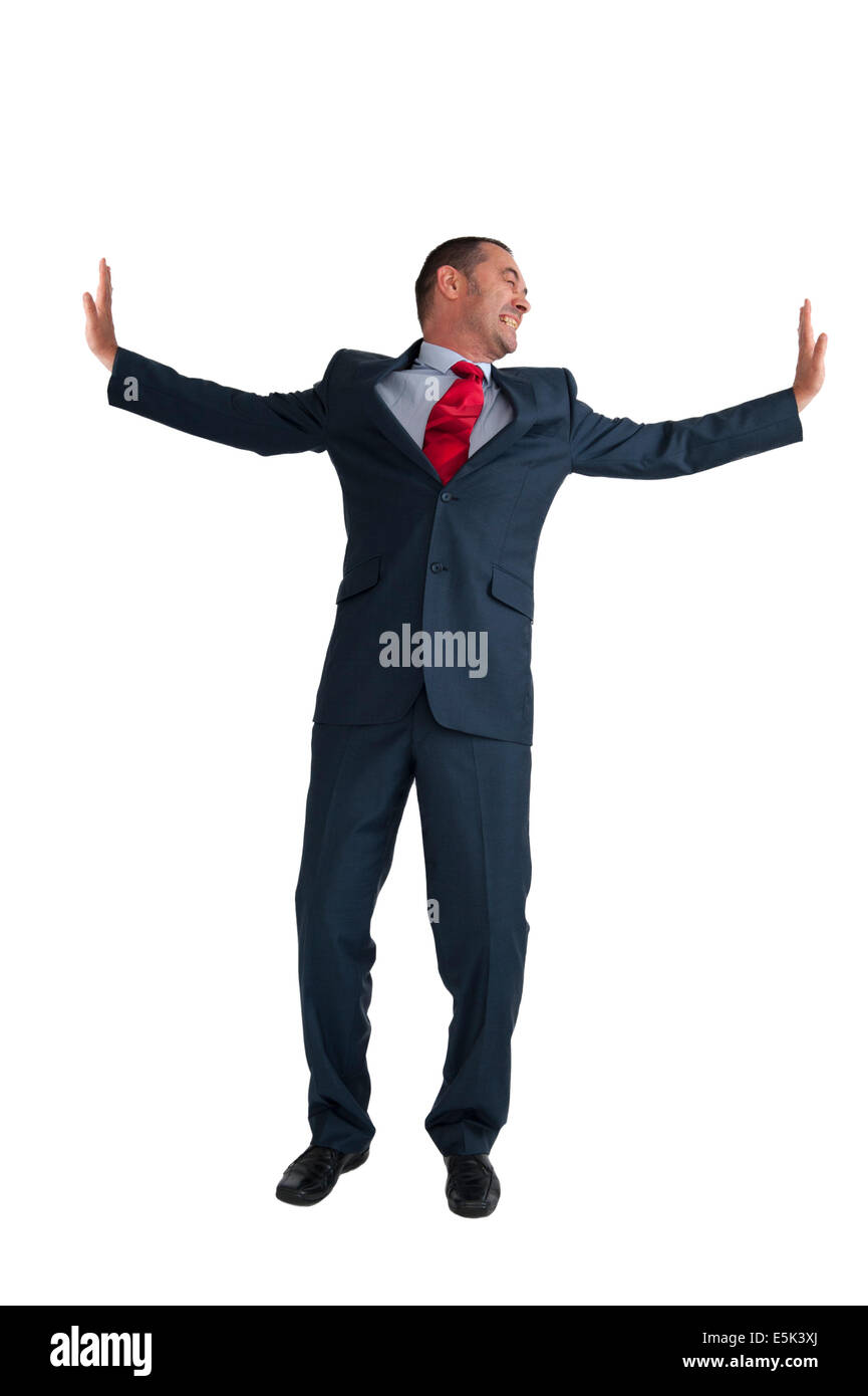 businessman pushing outwards isolated on a white background - Stock Image