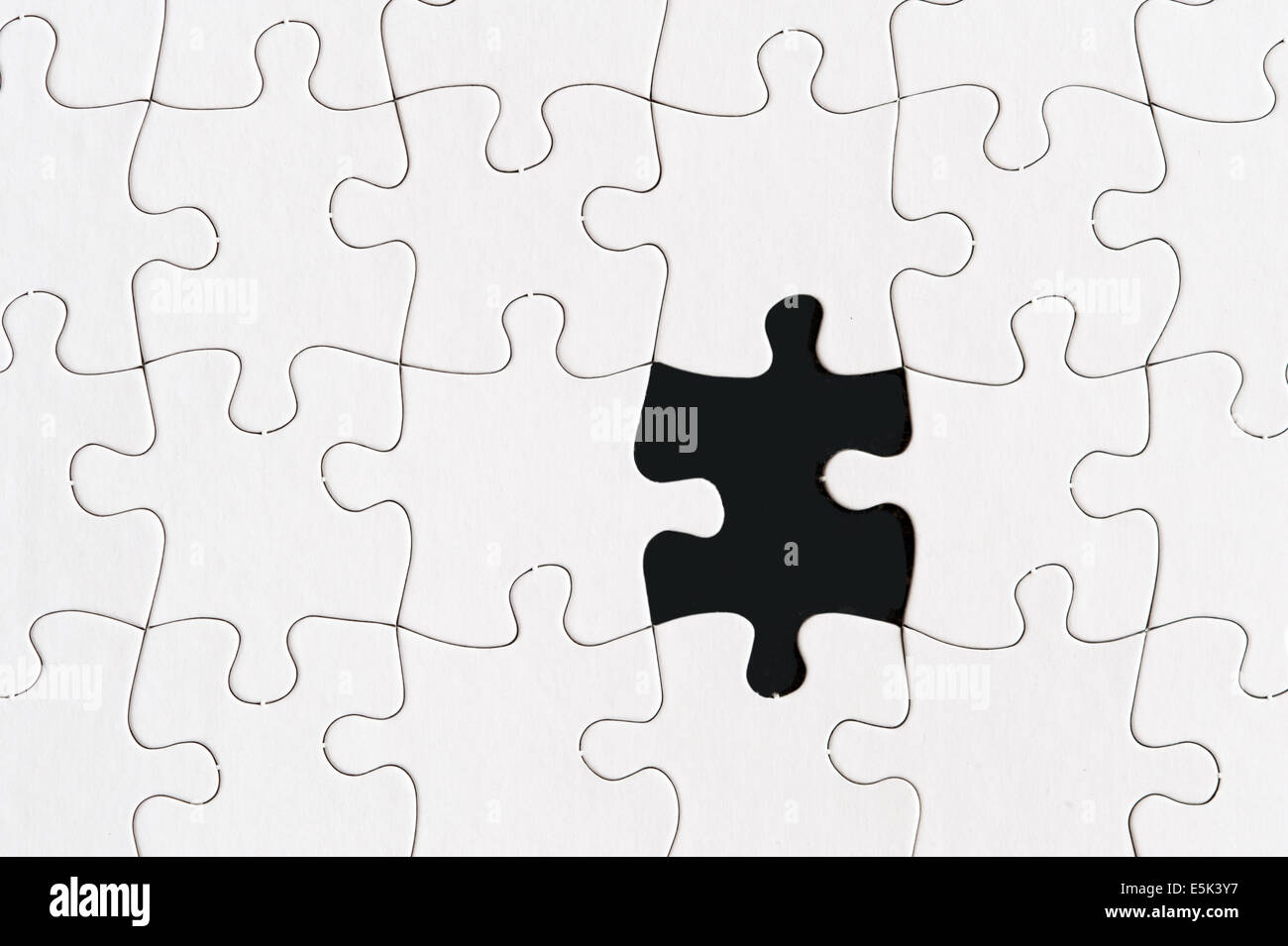 blank jigsaw puzzle with one missing piece - Stock Image