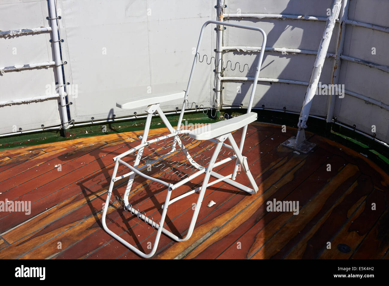 abandoned ship deck chair - Stock Image