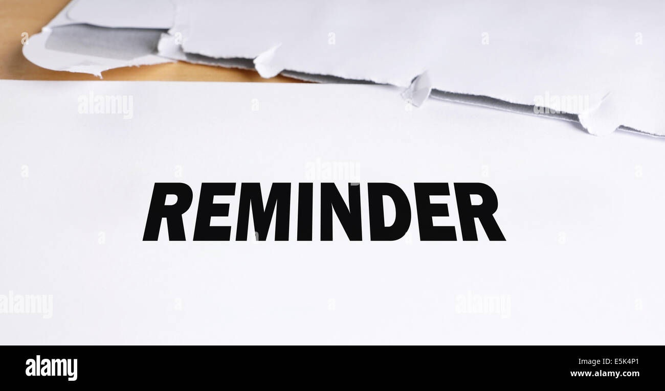 reminder letter opened on desk - Stock Image