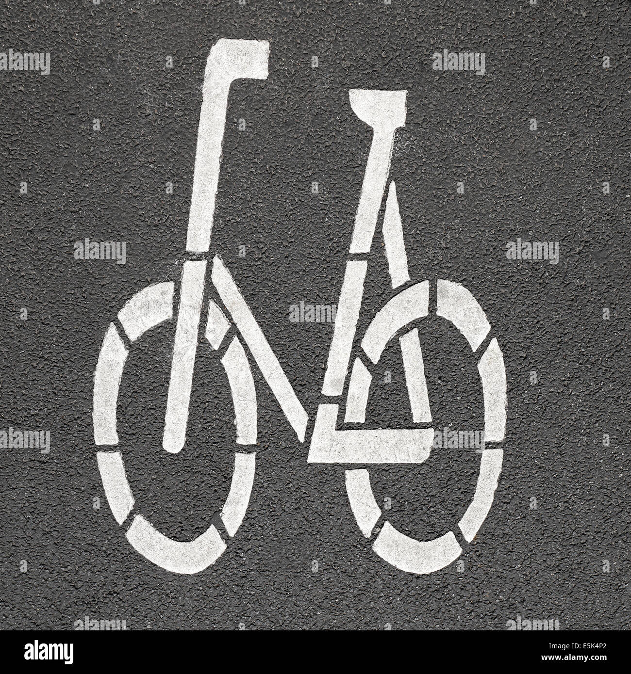 bicycle pictogram painted on asphalt - Stock Image