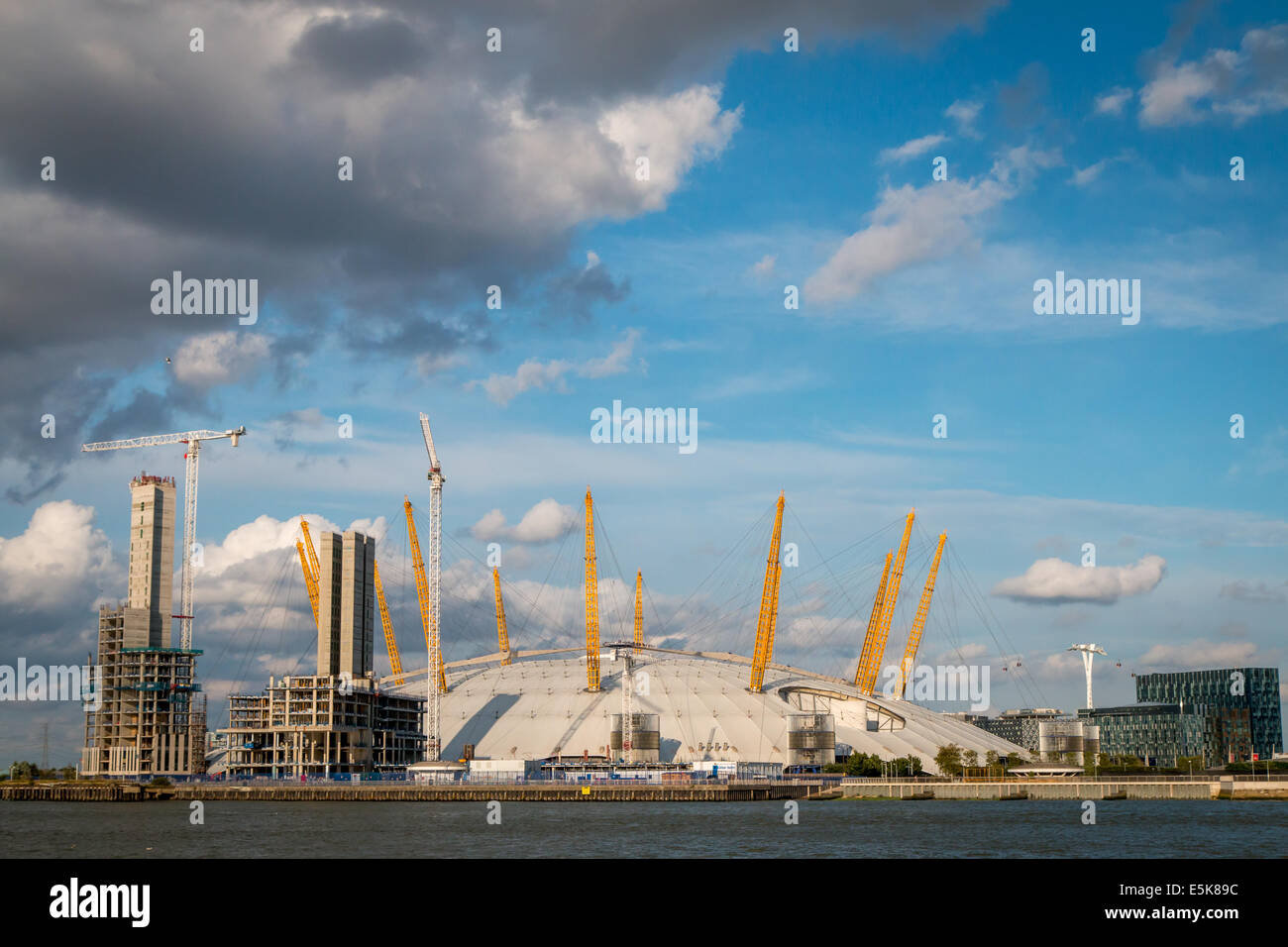 view of the O2 Arena and tower blocks being built at the Greenwich Peninsula - Stock Image