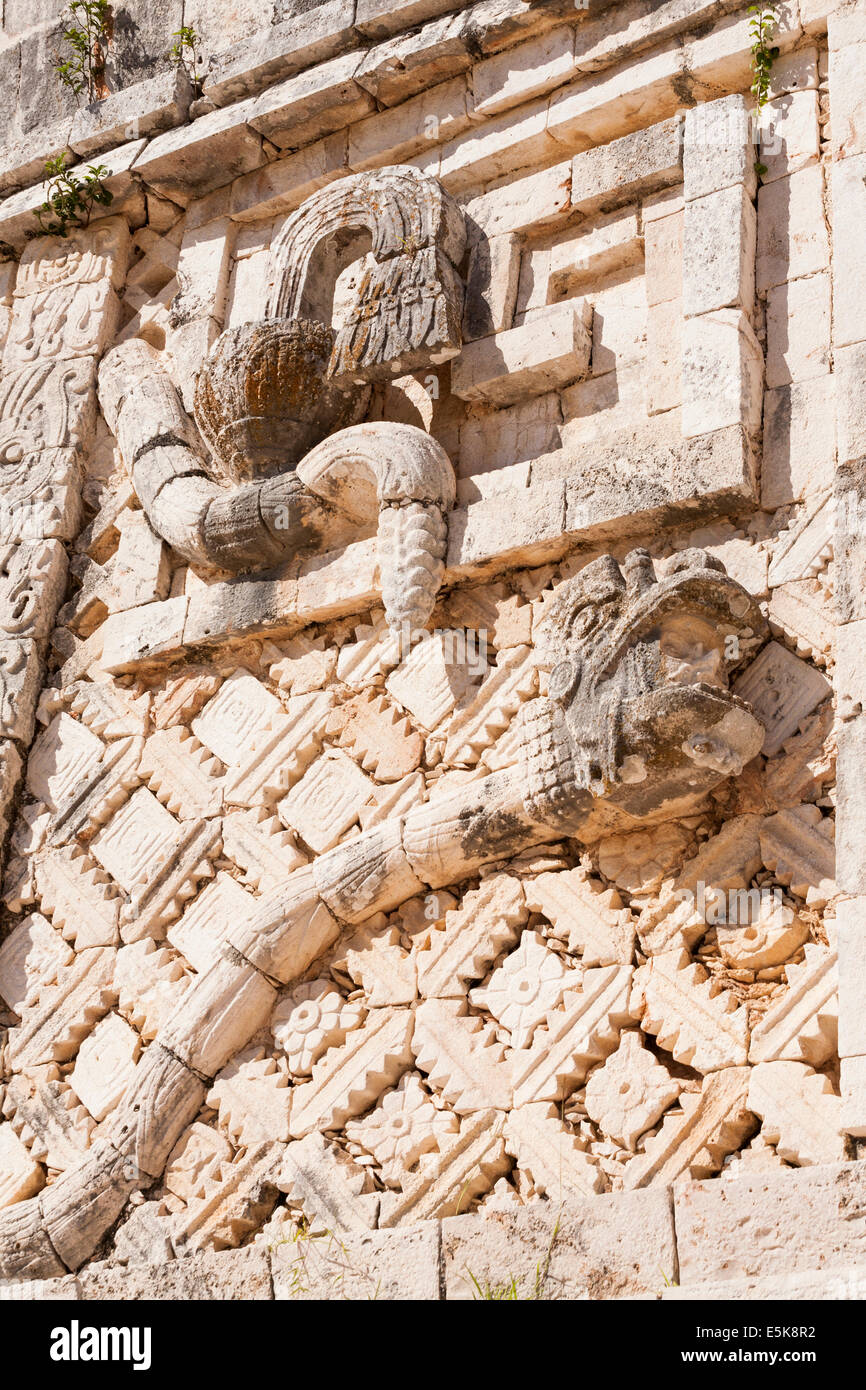 Snake Head and tail: Details from the facade in the Nunnery Quat. A long snake figures large in the detailed carved - Stock Image