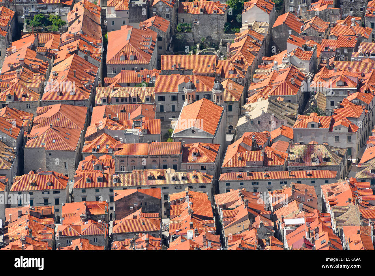 Looking down on rooftops within the walled city of Dubrovnik from Mount Srd - Stock Image