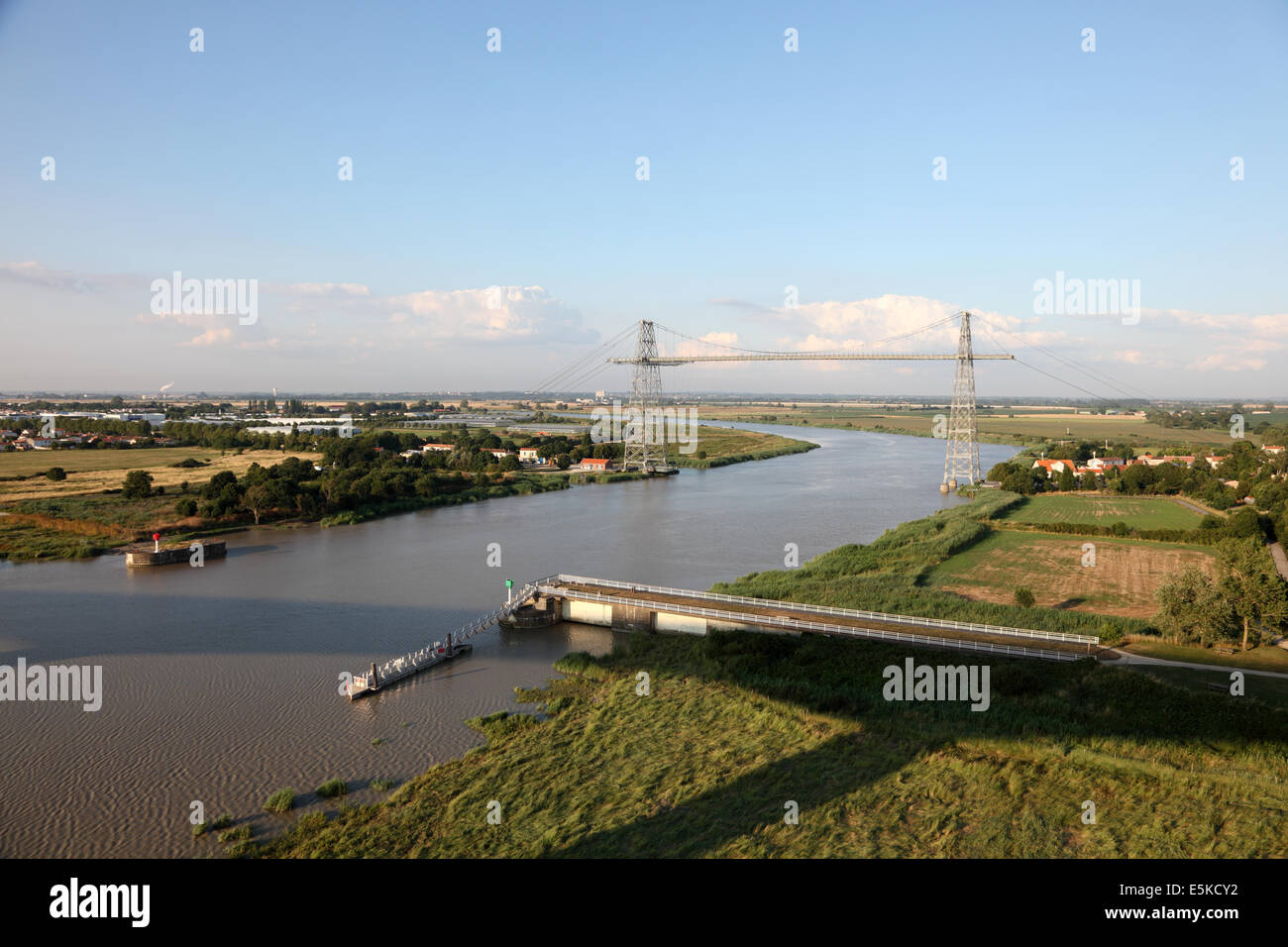 Transporter bridge crossing the Charente river between Rochefort and Echillais in the Charente-Maritime, France - Stock Image