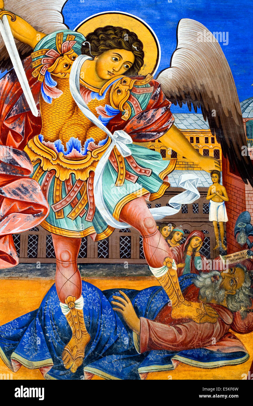 Iconic mural of angel and unbeliever painted on the wall of the Rila Monastery in Bulgaria - Stock Image