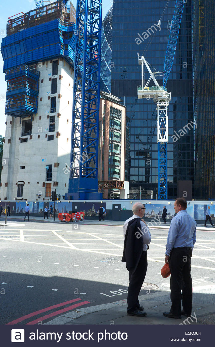 Two gentlemen discuss matters as the Pinnacle construction site provides a backdrop. Bishopsgate, in the City, London, - Stock Image