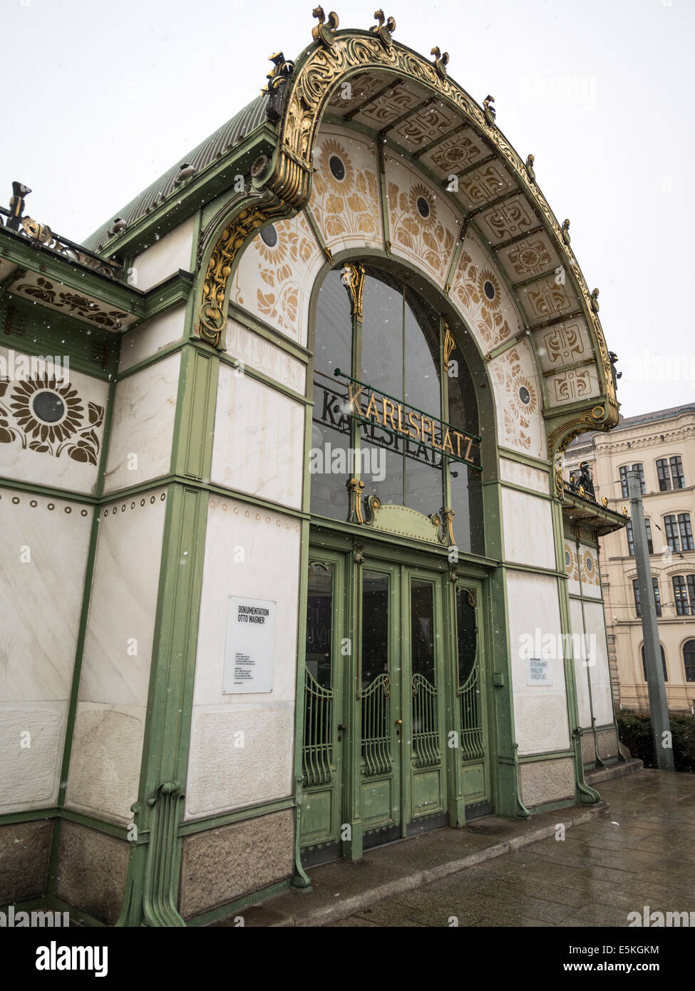 The Old Karlsplatz Underground Station Entrance in the snow. A highly decorated entrance structure, typical of the - Stock Image