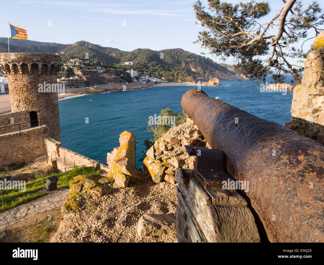 Rusty Cannon at Tossa de Mar Castle overlooking the sea. A cannon aimed at the beach located on the walls of Tossa - Stock Image