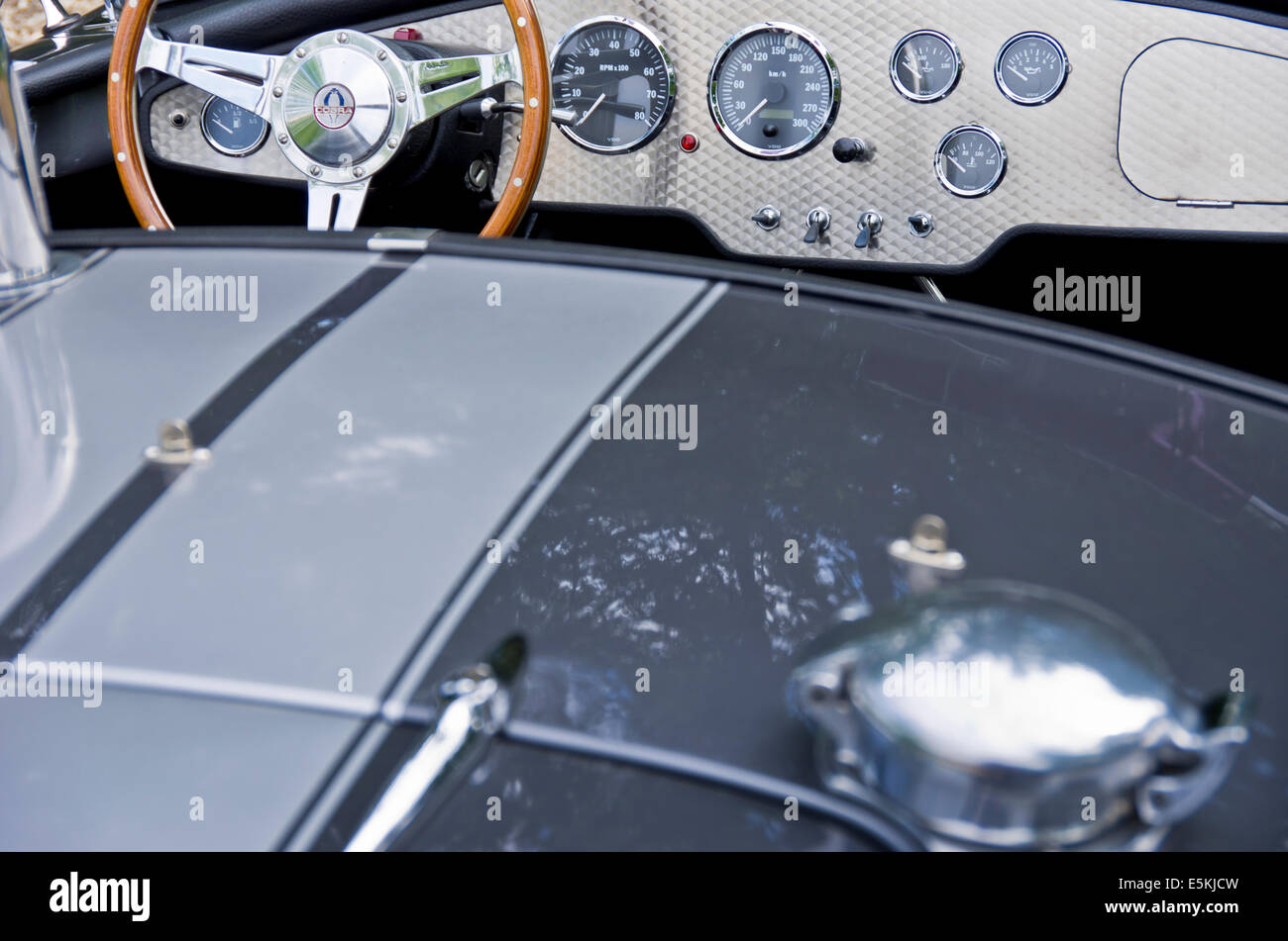Steering wheel and dashboard of a Shelby Cobra 427. Stock Photo