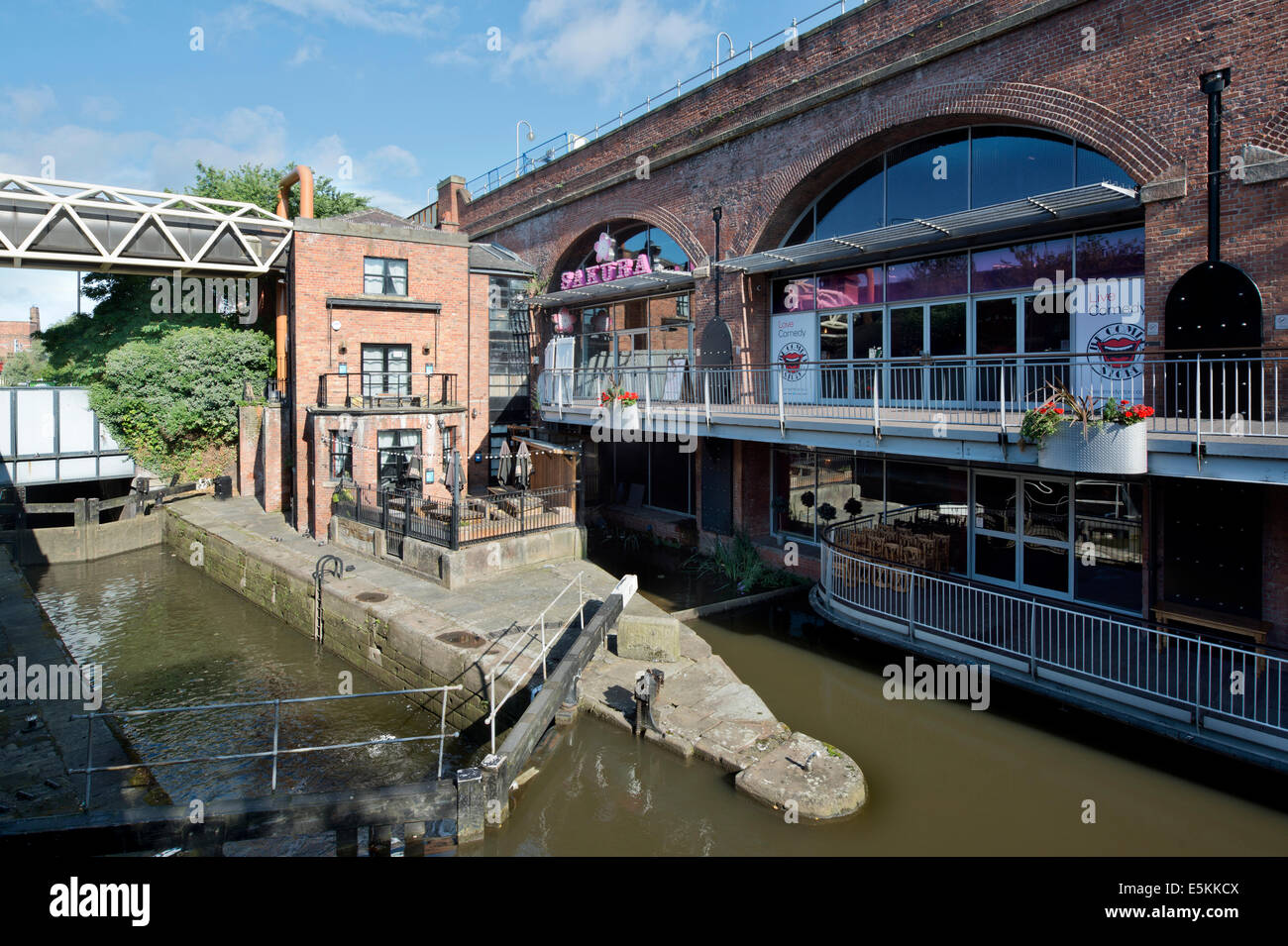 Sakura and The Comedy Store, and another neighbouring bar in the summer sunshine at Deansgate Locks in Manchester. - Stock Image