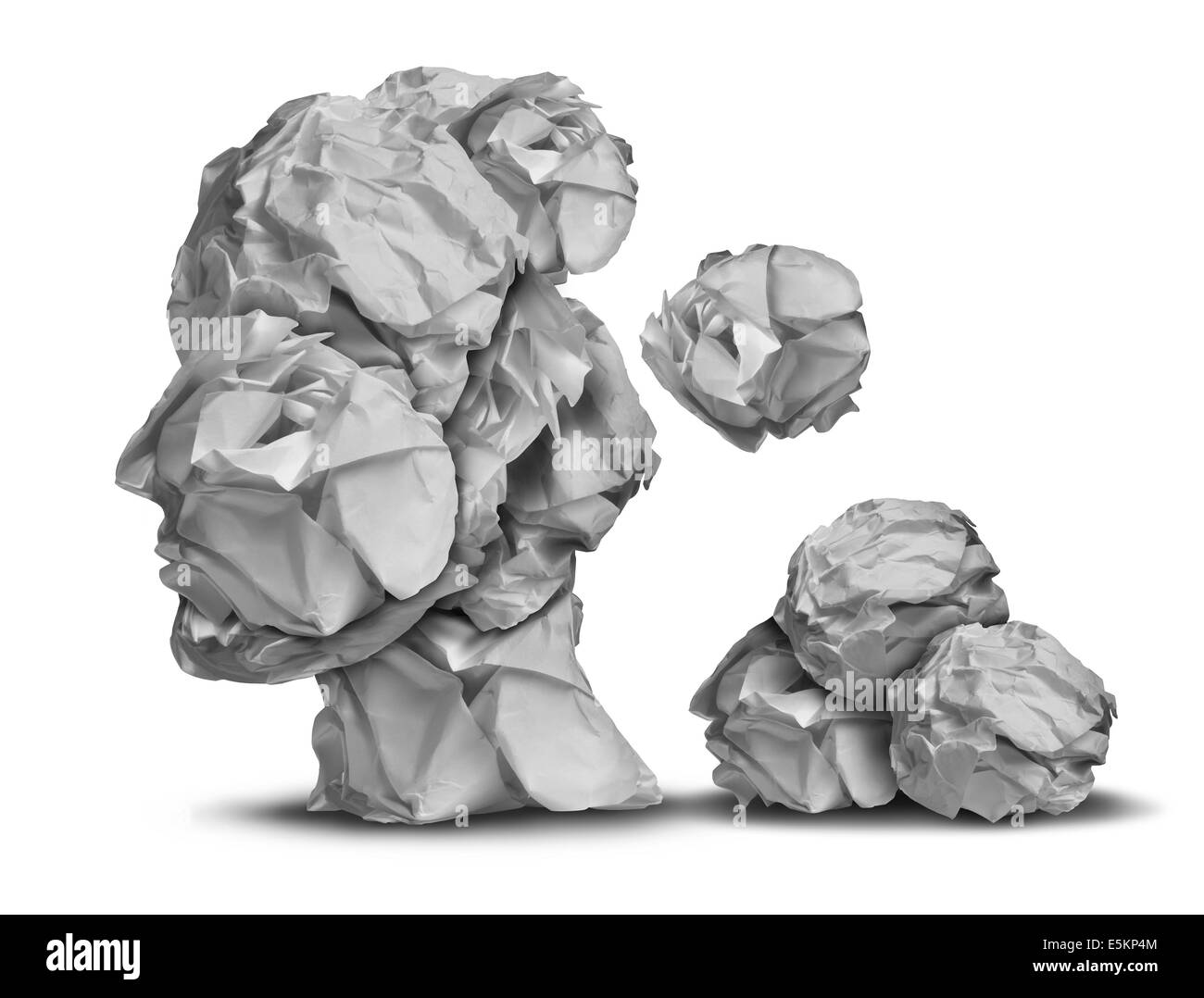 Dementia loss and work stress concept as a group of crumpled office papers falling down shaped as a human head as - Stock Image