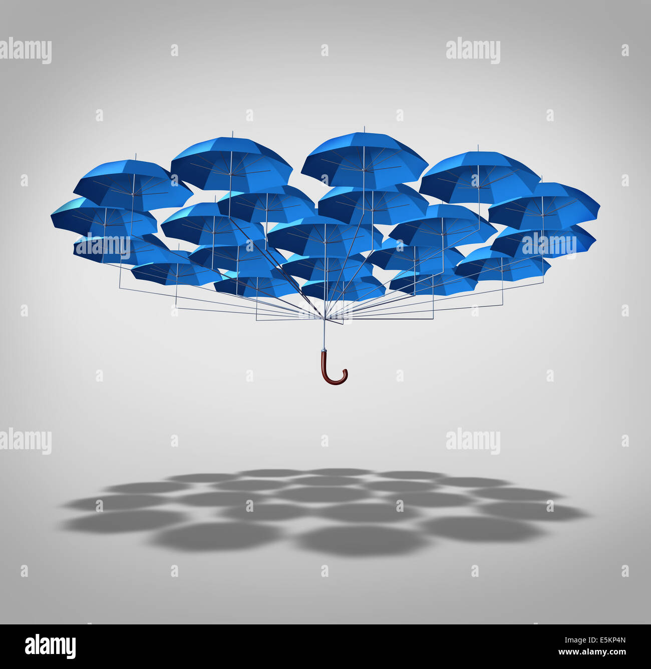 Extra security concept as a wide group of blue umbrellas connected together as one umbrella as a symbol of supplemental - Stock Image