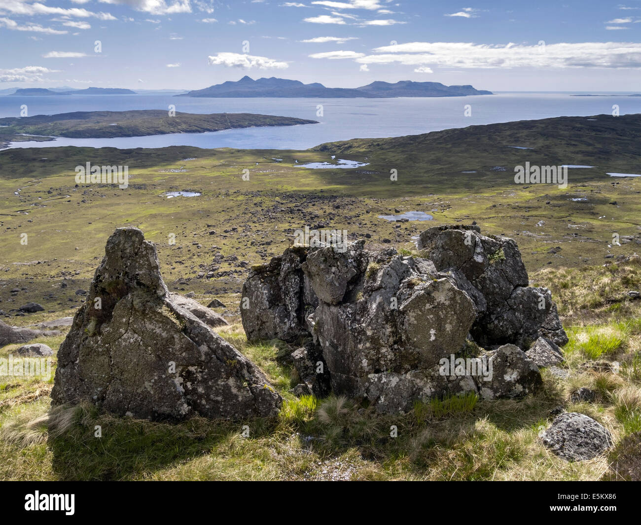 Rocky slopes of Sron na Ciche on Skye with the Hebridean Islands of Soay, Eigg and Rum beyond, Glenbrittle, Scotland, - Stock Image