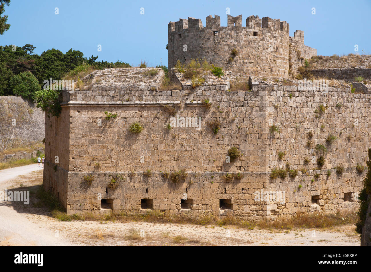 Defensive walls and moat outside old town, Rhodes town, Rhodes island, Dodecanese islands, Greece, Europe - Stock Image