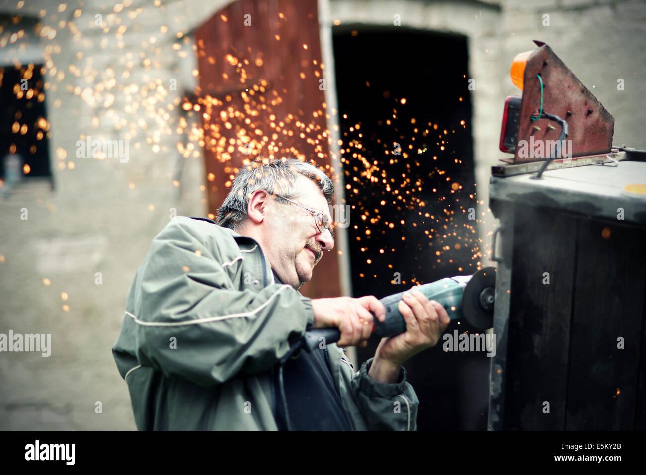Man at work - Stock Image