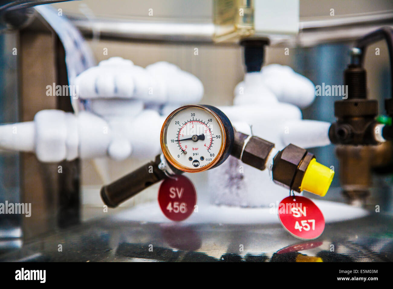 A pressure gauge in a science research laboratory. - Stock Image