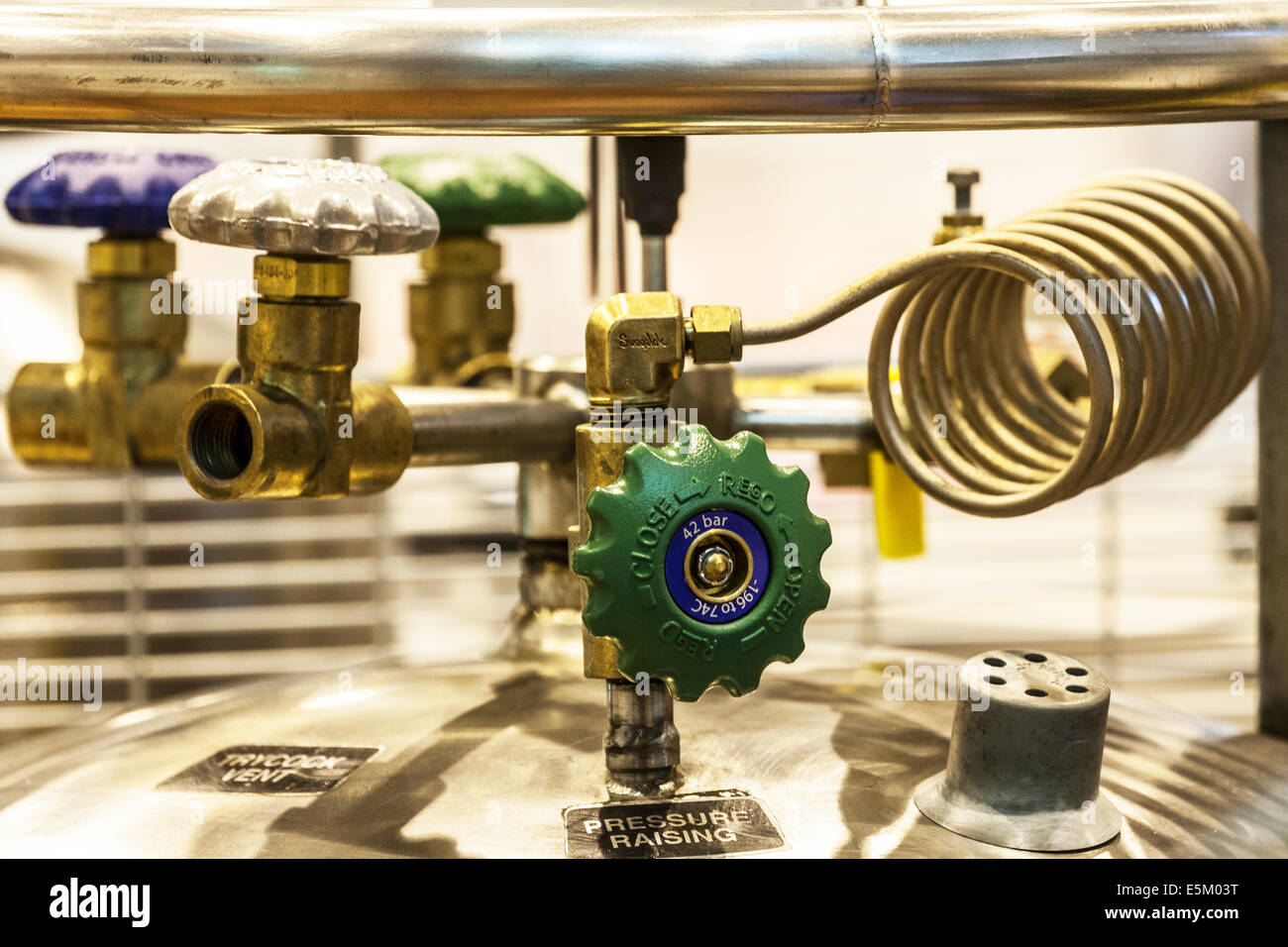 A pressure valve on top of a cylinder of gas in a science research laboratory. - Stock Image