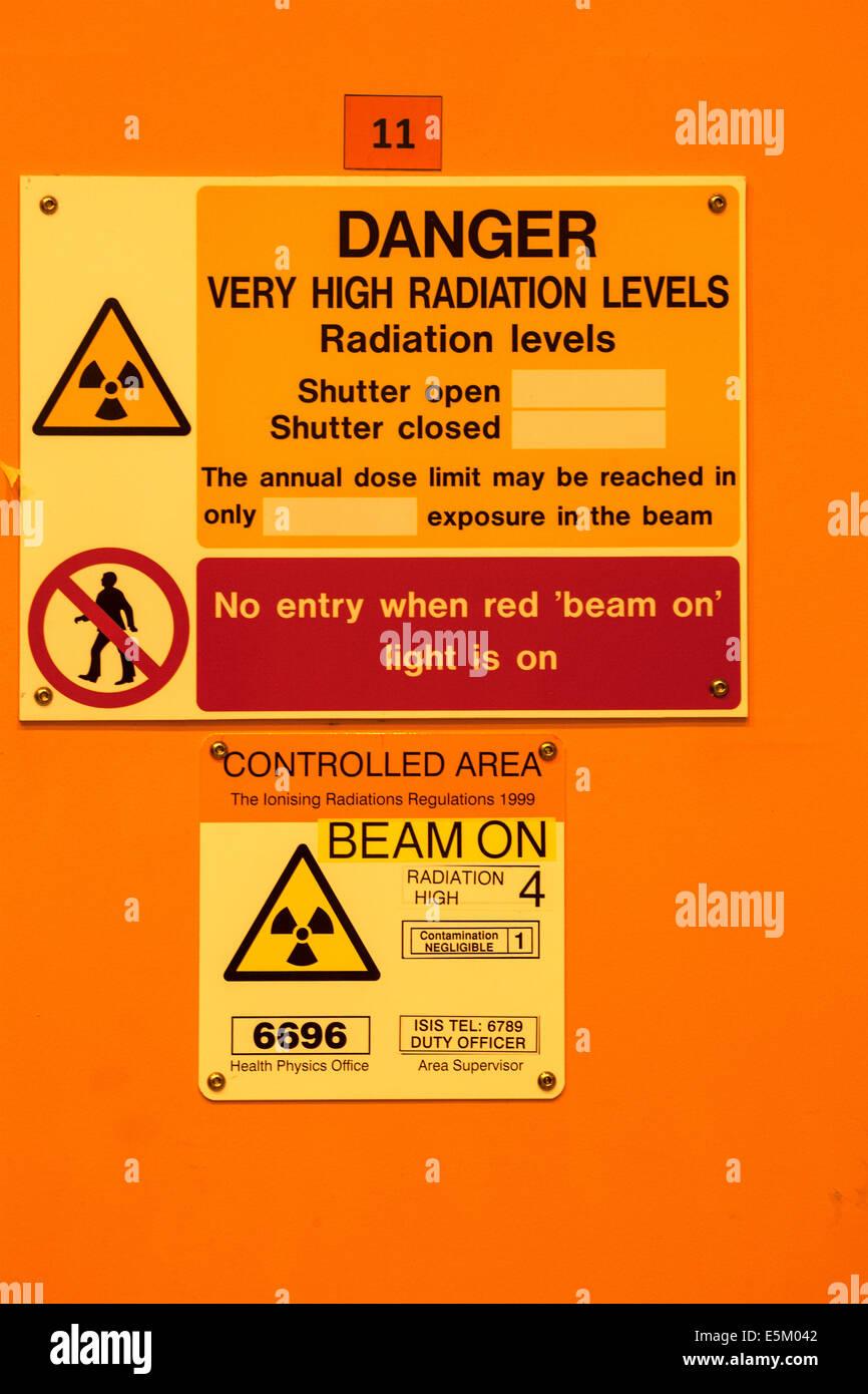 Radiation warning outside a laboratory in a scientific reseach establishment. - Stock Image