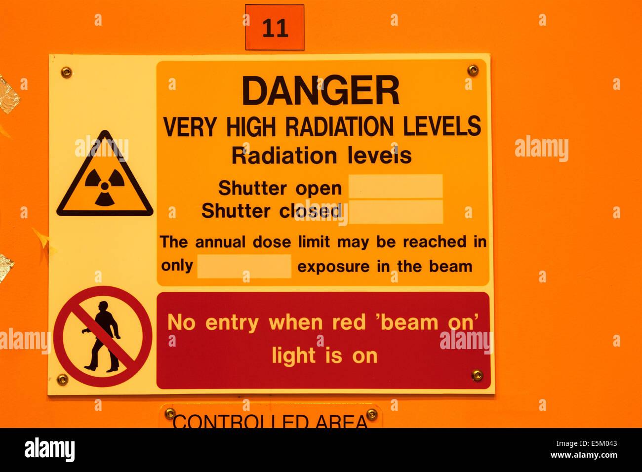Radiation warning outside a laboratory in a scientific reseach establishment. Stock Photo