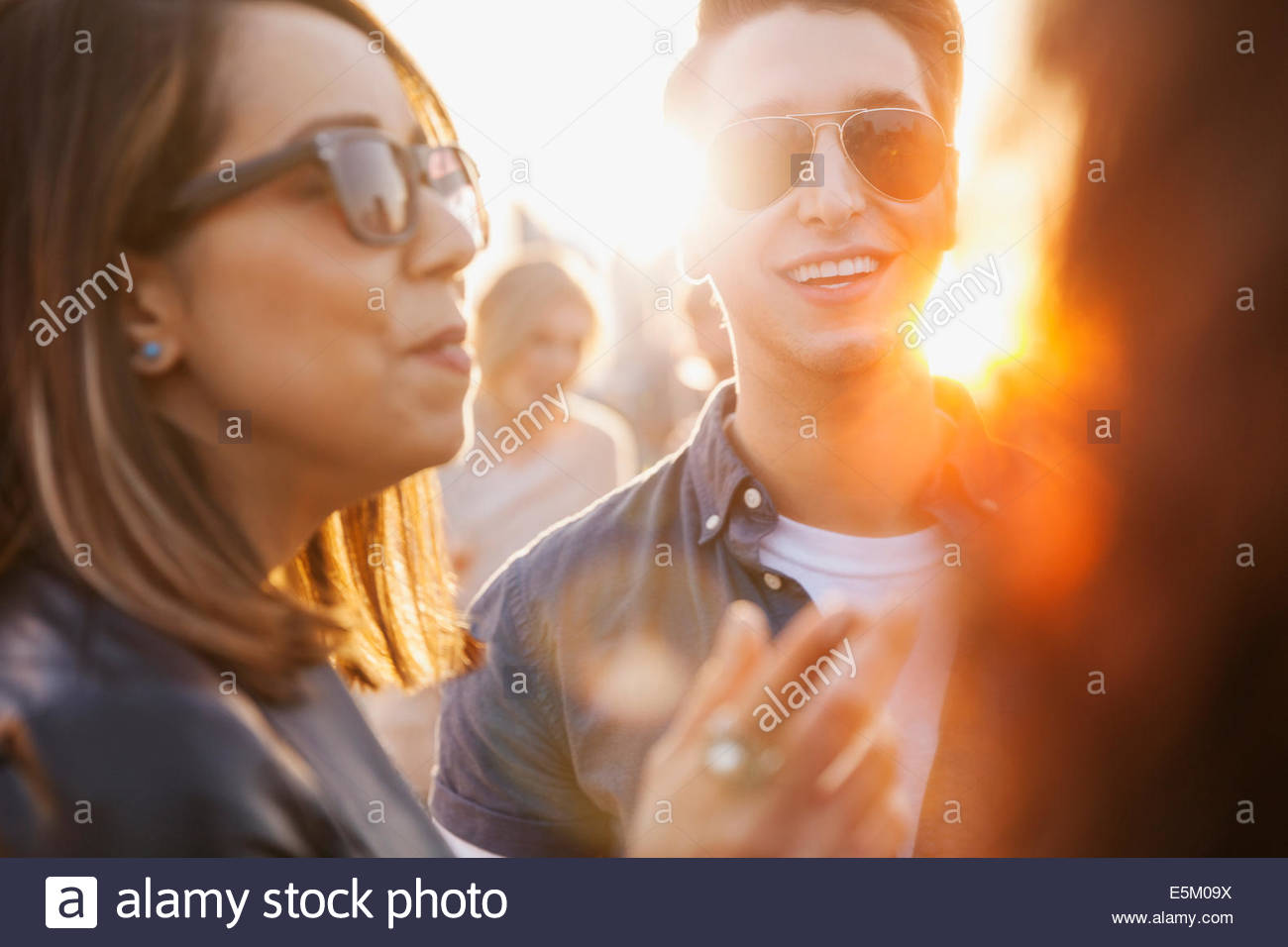 Friends talking outdoors - Stock Image