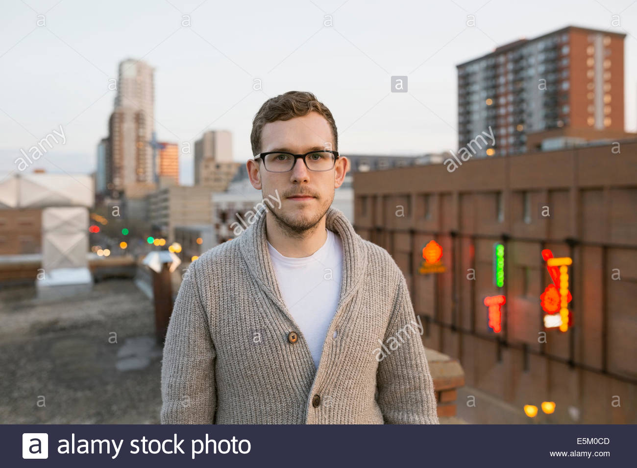 Portrait of serious man on urban rooftop - Stock Image