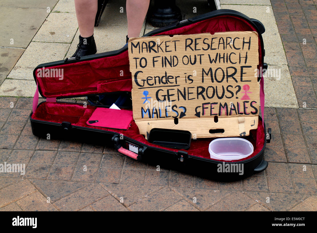 Busker`s guitar case with sign, Stratford-upon-Avon, UK - Stock Image