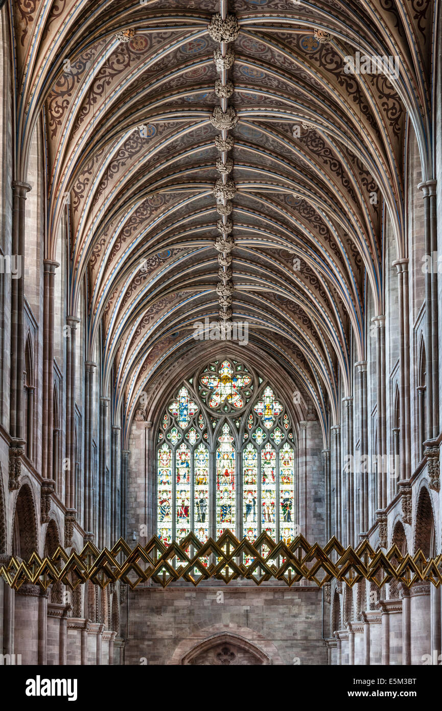 Hereford Cathedral, UK. An interior view of the nave towards the west window, past the Corona - Stock Image