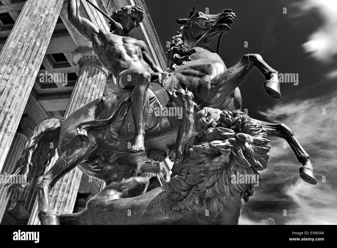 Germany, Berlin: Side view of a equestrian statue of a Lion fighter in front of the Altes Museum - Stock Image