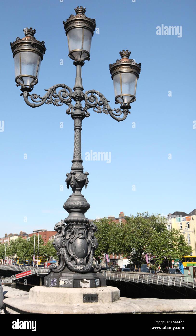 Victorian triple lamp on O'connell bridge Dublin - Stock Image