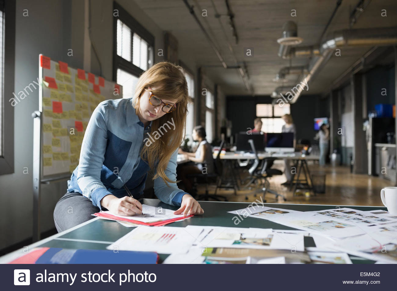 Creative businesswoman working in office Stock Photo