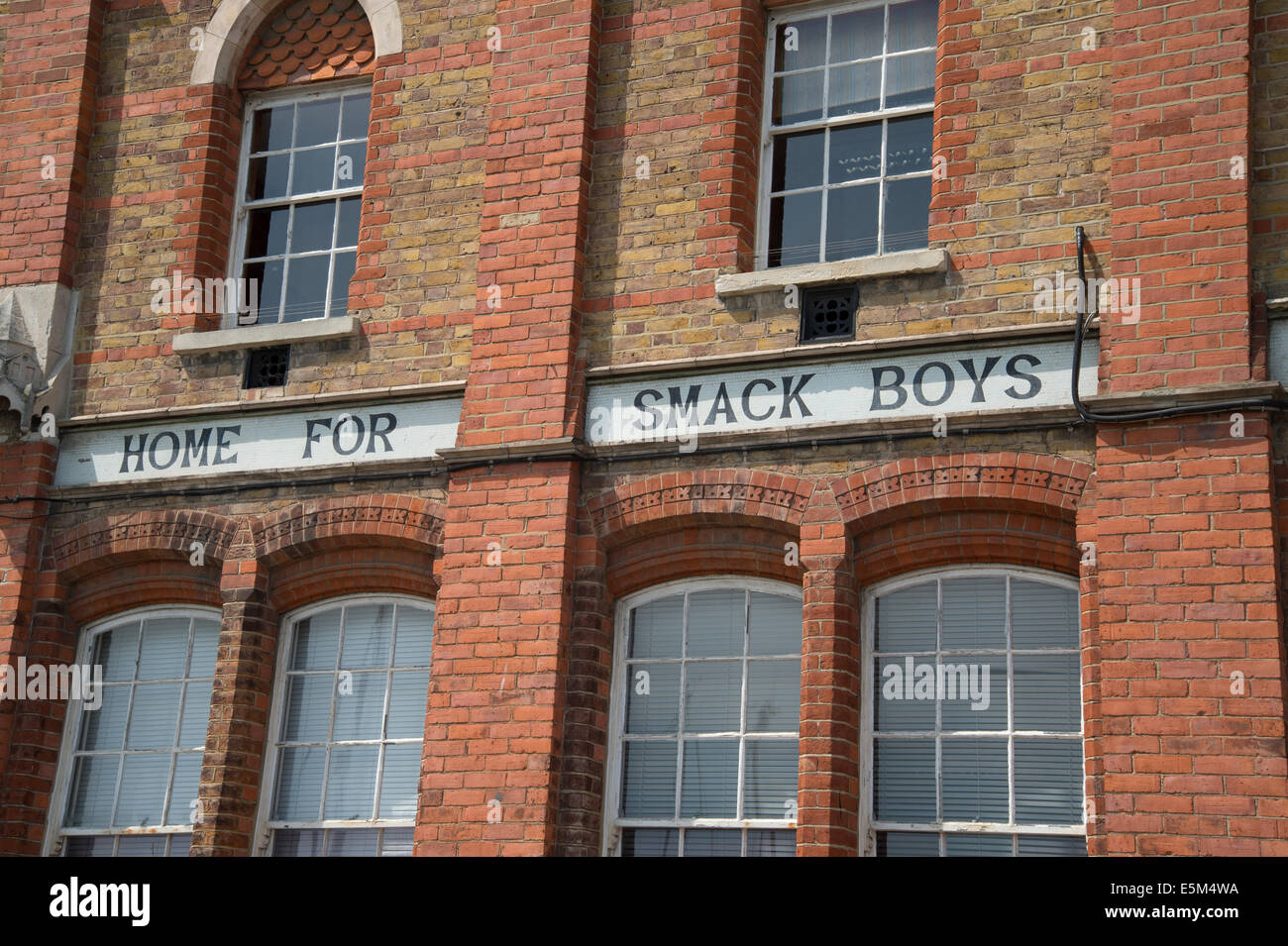 Ramsgate, Kent. Restored red brick building with sign 'Home for Smack Boys' - Stock Image