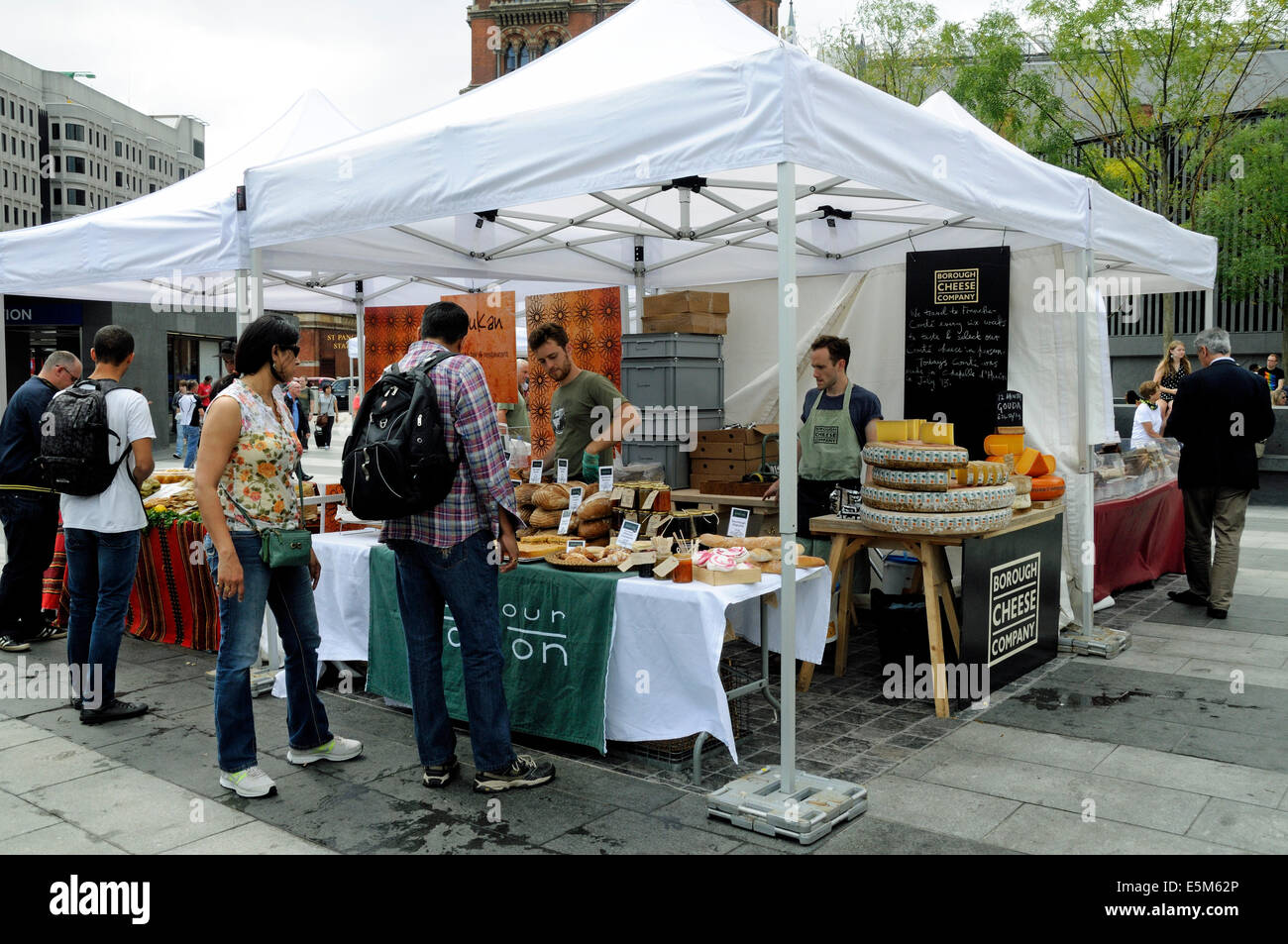 People at the Flour Station stall, Kings Cross Real Food Produce Market, Kings Cross Station Square, London England - Stock Image