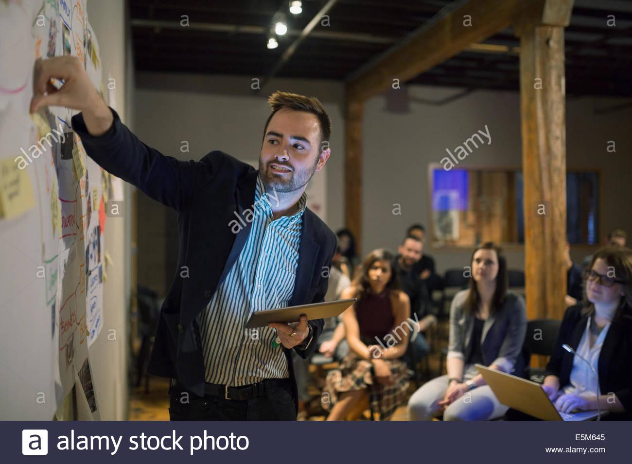 Audience watching speaker lead presentation - Stock Image