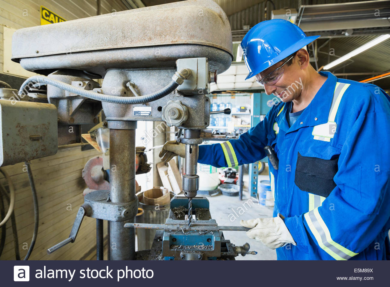 Male worker using equipment in gas plant - Stock Image