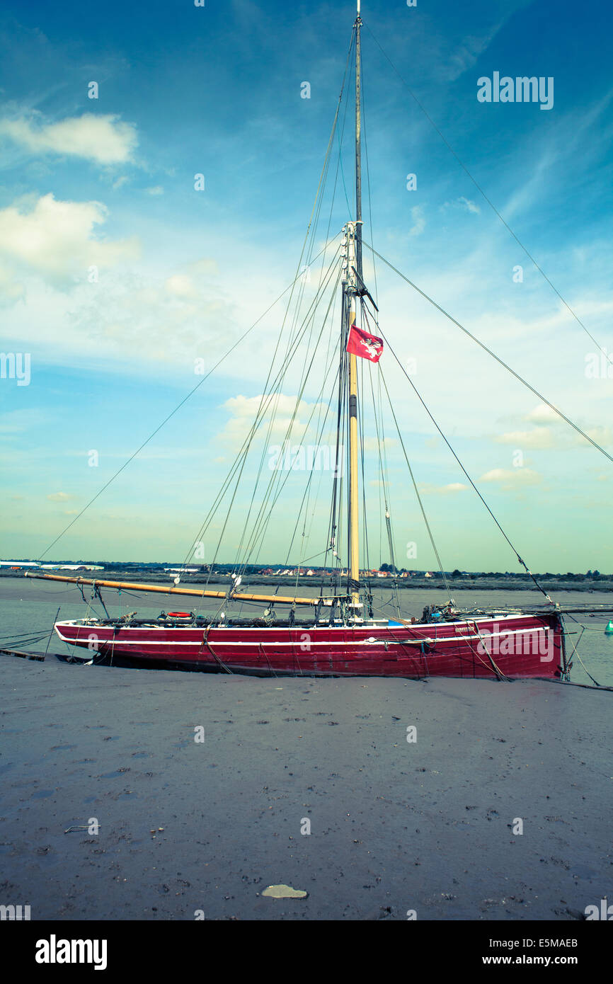 Red Sailing Boat at Burnham on Crouch Essex UK - Stock Image