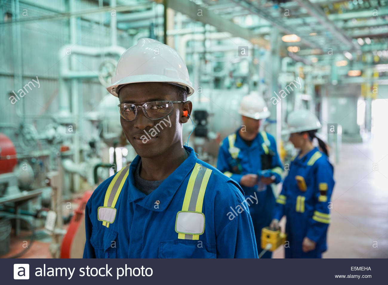 Portrait of male worker in gas plant - Stock Image
