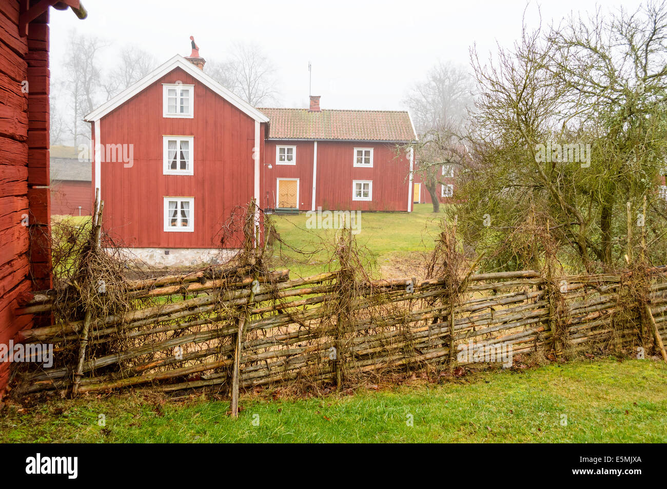 Farm environment in Sweden from around the years 1700 to 1800. Main farm buildings for the farmer with family. - Stock Image