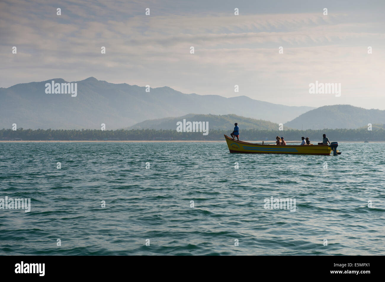 People in a boat Dolphin spotting. Palolem, Goa India - Stock Image