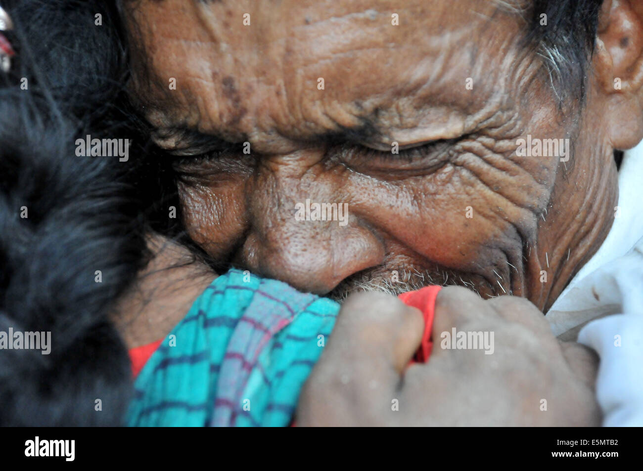Mawa. 4th Aug, 2014. A man mourns for his missing relatives after a ferry accident in Munshiganj district, some - Stock Image