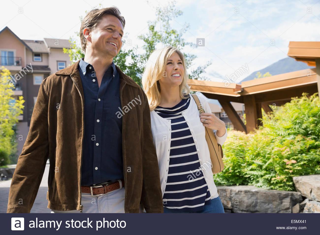 Couple walking outside hotel - Stock Image
