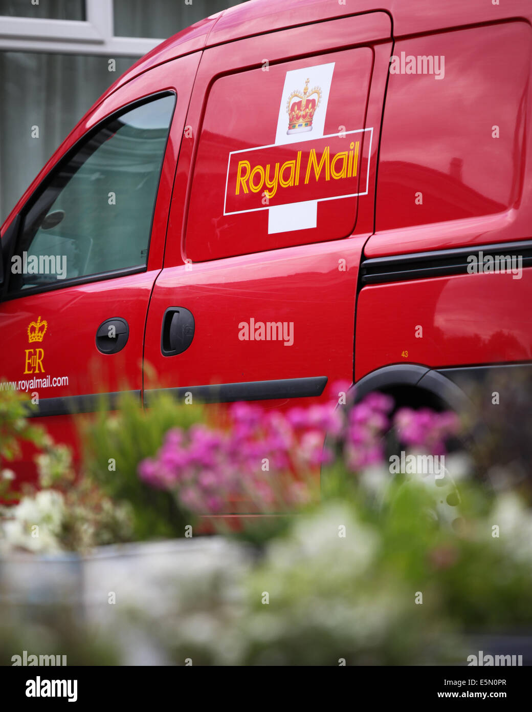 A Royal Mail delivery van parked outside the Royal British Legion in Old Basing, Hampshire, UK - Stock Image