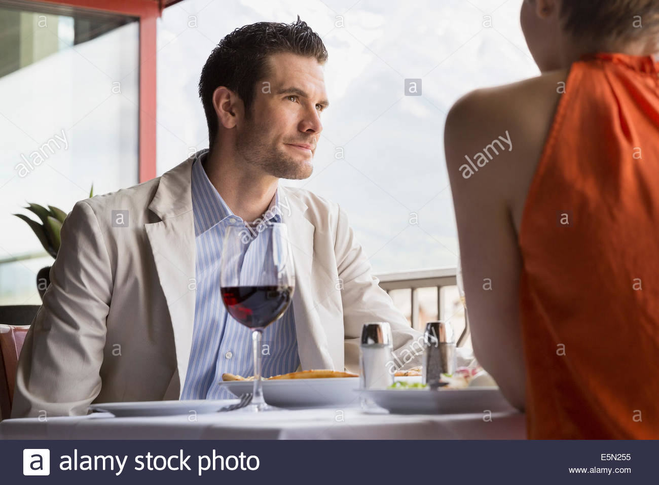 Couple at restaurant table Stock Photo